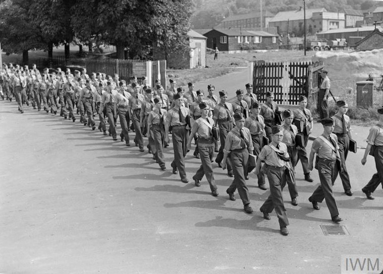 Aircraft apprentices march in shirt-sleeve order from their living quarters to the workshops at No. 1 School of Technical Training, Halton, Buckinghamshire, to begin their day's work.
